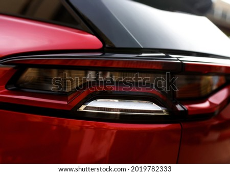 Rear LED headlamp of a modern car. Brake taillight. Red stop lighting of highway vehicles. Cars ambient lighting. Cars taillight decorative frame ABS plastic  Stockfoto ©