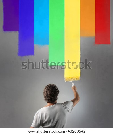 rear of man painting a colorful wall