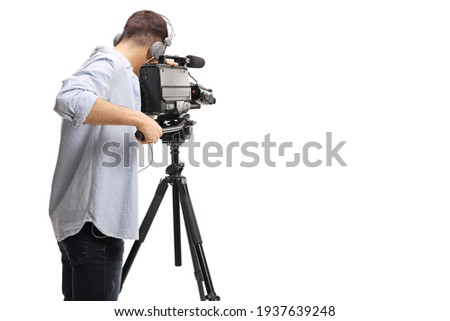 Rear shot of a cameraman recording with a professional camera on a stand isolated on white background Foto stock ©
