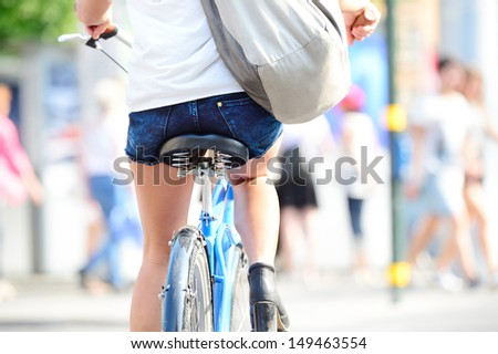 Rear shot of bicyclist - stock photo