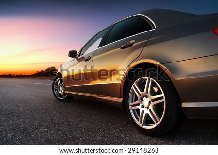 "stock photo rear side view of a luxury car on sunset 29148268 - Каталог - Фотообои ""Автомобили"""