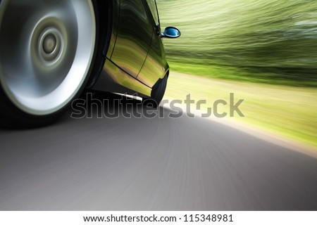 rear side view of a sport car in blurred motion