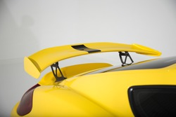 Rear spoiler on yellow sports car