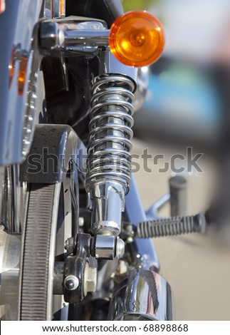 Rear suspension of a chopper motorbike