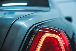 Rear tail light of stylish luxury car with pinstripe details. Close up view of classy prestigious vehicle.