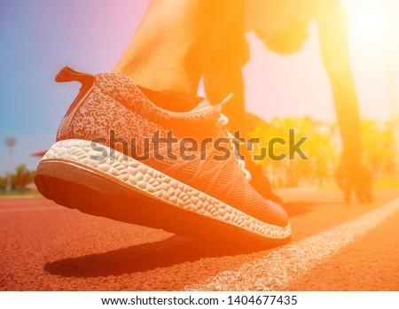 Rear view. athlete on starting position at athletics running track. Sports background