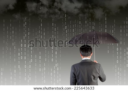 rear view Businessman with an umbrella among binary code digital rain storm antivirus and firewall protection concept