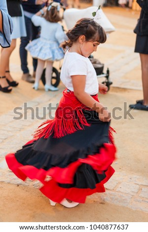 5cf01a4c6647 Rear view child dancing wearing typical spanish regional costume. Flamenco.  Andalucia. Spain