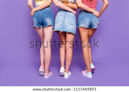 Rear view cropped portrait of lesbians trio hugging having booty butt demonstrate hairless ideal legs isolated on vivid violet background. Pampering weightloss diet weight loss concept #1115469893