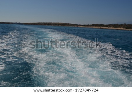 Rear view from ship to the sea and Chrissi island (Greece)