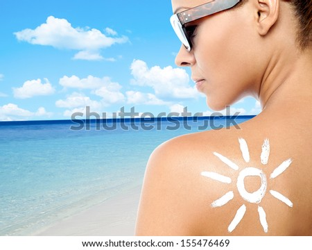 Rear view image of a woman with sunscreen lotion #155476469