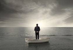 Rear view of a businessman on a boat in the sea