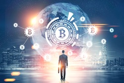 Rear view of a businessman with a suitcase looking at a bitcoin network with a bitcoin sign inside an HUD, world map. Night city. Toned image double exposure Elements of this image furnished by NASA