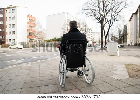 Rear View Of A Disabled Man On Wheelchair Looking At Street #282617981
