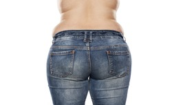 rear view of a fat woman in jeans on white background