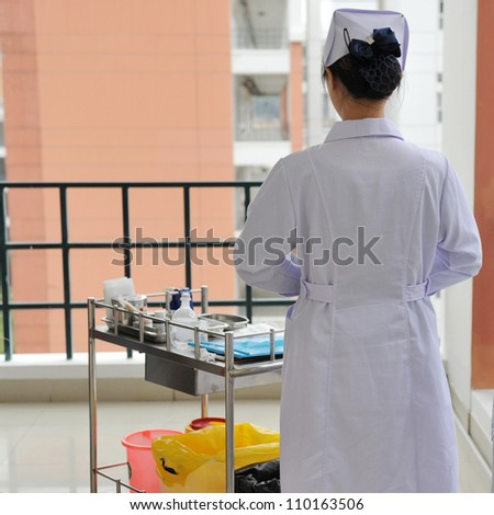 Rear view of a female doctor or nurse.