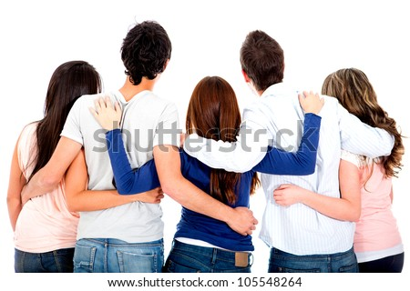 Rear view of a group of friends hugging - isolated over a white background