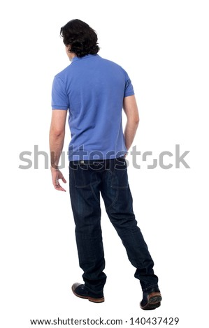 Rear view of a handsome man against white background