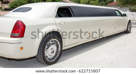 Rear view of a long white limousine car #622715807