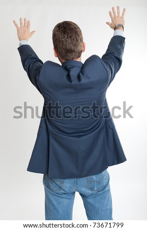 Rear view of a man extending his hands