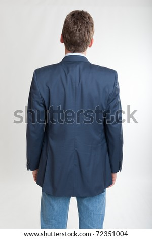 Rear view of a man looking at something