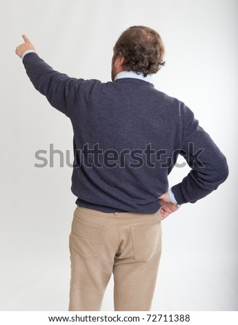Rear view of a man pointing with his finger