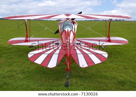 Rear view of a red biplane, now used for aerobatics.