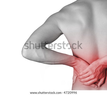 Rear view of a young male Holding his back in pain.