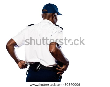 Rear view of afro American police officer pulling out handcuffs in studio on white isolated background