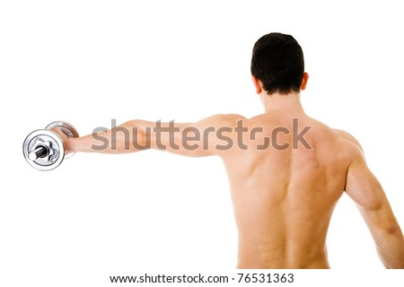 Rear view of an young man with outstretched arms holding dumbbell against white background - stock photo