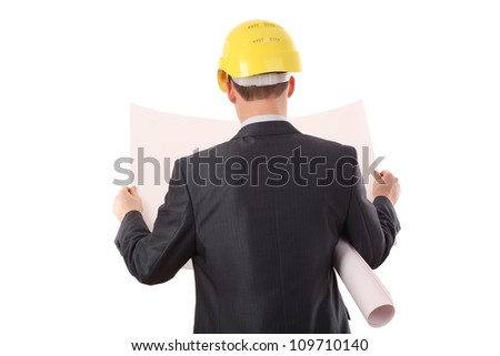 Rear view of architect looking comparing housing project with building On white background