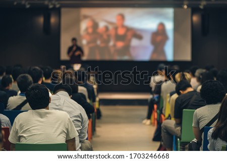Rear view of Asian audience joining and listening speaker talking on the stage in the seminar meeting room or conference hall, education and workshop, associate and startup business concept