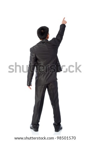 Rear view of asian young business man  pointing at copy space isolated over white background, full length portrait of businessman standing back