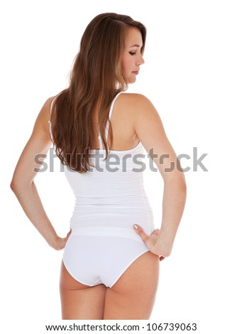 Rear view of attractive young woman in white underwear. All on white background.