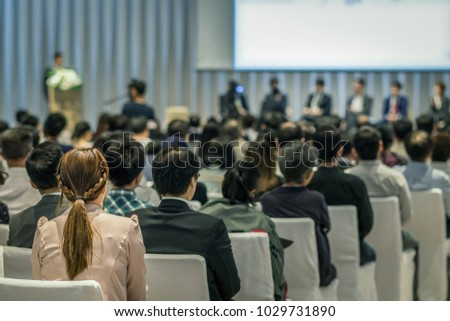 Rear view of Audience in the conference hall or seminar meeting which have Speakers on the stage, business and education about investment concept
