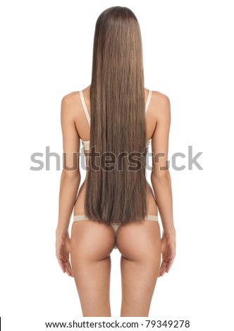 Rear view of beautiful woman with long straight brown hair and slim body. Isolated on white background