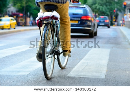 Rear view of bicyclist - stock photo