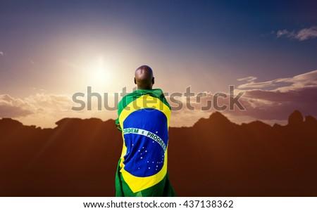 Rear view of brazilian sportsman against composite image of landscape #437138362