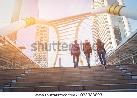 Rear view of business team climbing stairs go to a city. Business concept Сток-фото ©