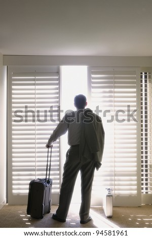 Rear view of businessman in hotel room