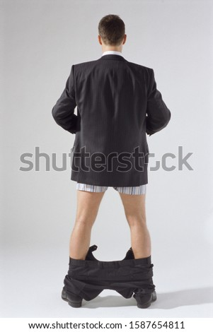 Rear view of businessman with his pants down