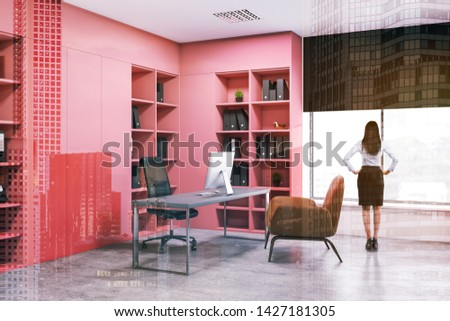 Rear view of businesswoman standing in modern office with pink bookcases with folders and gray computer desk with armchair for visitors. Concept of management. Toned image double exposure #1427181305