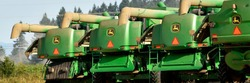 Rear view of combines and a tractor ready for a day of grass seed harvest.  Willamette Valley Oregon