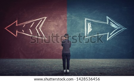 Rear view of doubtful businesswoman in front of a split wall as arrows leads in two different ways red and blue side. Correct choice left or right, failure or success. Difficult decision concept.