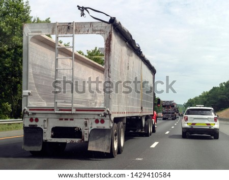 Rear view of empty semi truck on interstate highway. #1429410584