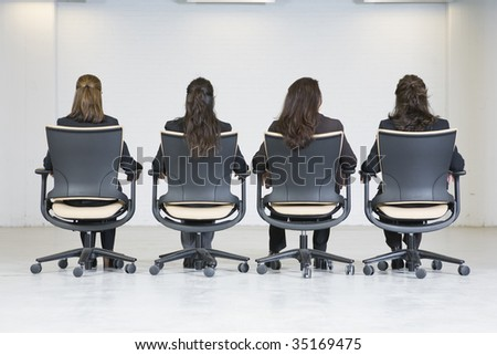 Rear view of four business women