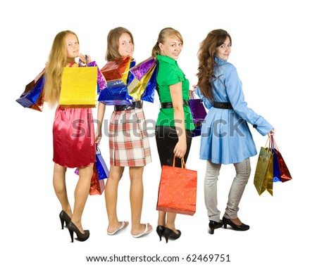 Rear view of girls holding shopping bags. Isolated in full length on white background