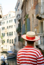 Rear view of gondolier in Venice, Italy