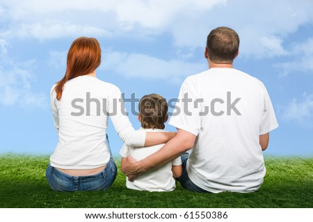 Rear view of mother, father and son sitting together