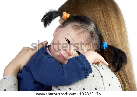 Rear view of mother with cute asian baby girl looking over shoulder